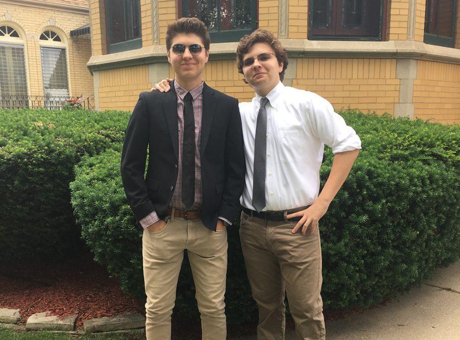 Senior+Noah+Tennison+and+Freshman+Eli+Tennison+pose+outside+of+their+house