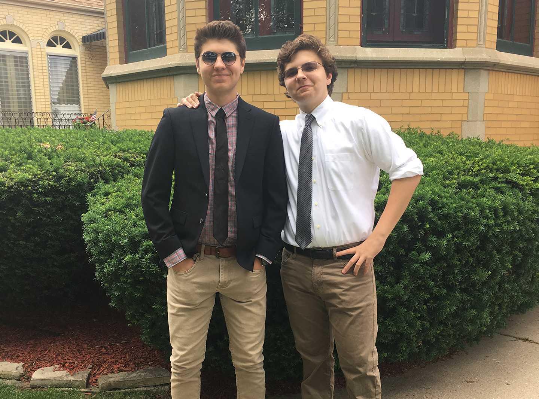 Senior Noah Tennison and Freshman Eli Tennison pose outside of their house