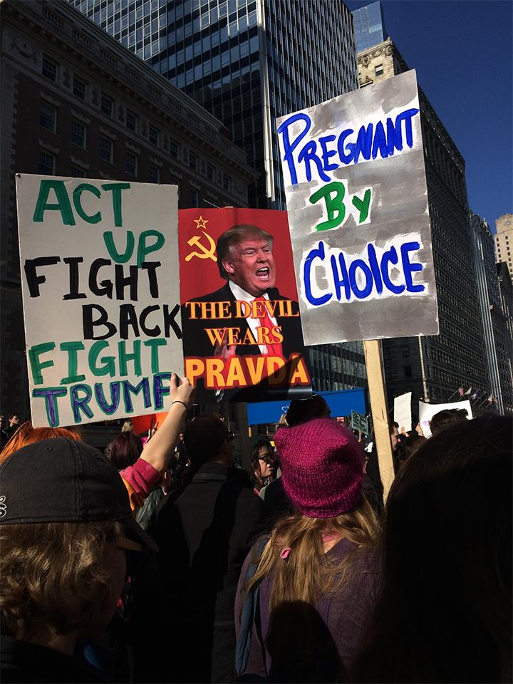 Protesters+hold+signs+at+the+Women%27s+March+in+Chicago