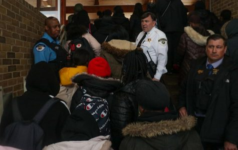 Students march past Oak Park police officers during their walkout Wednesday morning