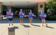 4 Leadership SILCS in charge of handing out signs, (left to right) Jackson Tanner, Jack Kiefer, Isabel Sichlau, and Ruby Dalton