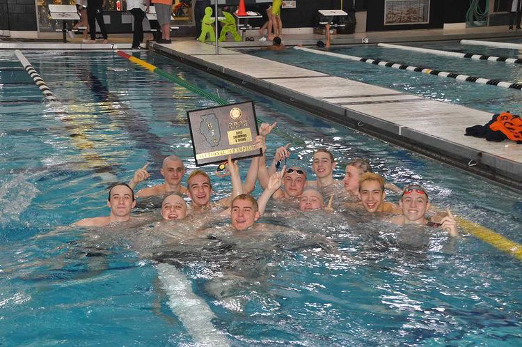 Members of the Boys Swim and Dive team celebrate their sectional win in February 2020