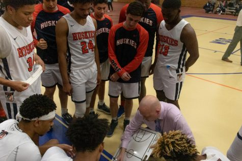 Rashaad Trice, top left, looks at Mr. Maloney, the former head coach, as he details a plan
