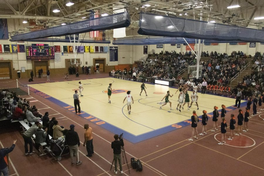 The boys basketball team playing during their last season, in January of 2020