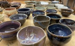 Students distribute handmade bowls at Empty Bowls 2021. Local studios Terra Incognito (246 Chicago Ave.) and ViaClay (208 S. Marion St.) helped with bowl production.
